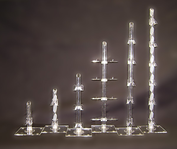 These individual counter top displays can display a single frame or up to six frames. The base is 10cm square with clear bump-ons and a fixing flange glued in the centre. The rods can be plain clear acrylic, a random bubble rod or a leaf patterned rod. The rod tops are cut on an angle and polished. The front loader clip, clearview clip and mini clip are suitable for these displays
